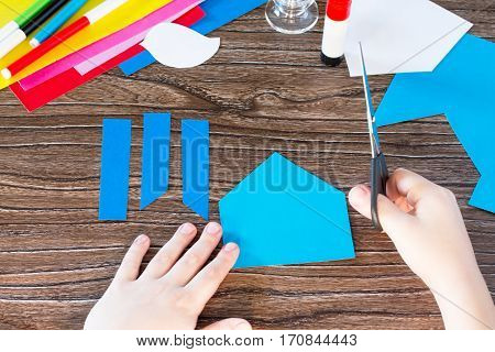 The Child Cuts Out Paper Details. The Child Create A Spring Greeting Card Paper. Made By Hand. Craft