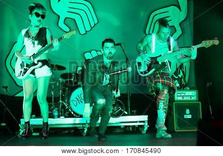 HUNTINGTON, NY-FEB 8: (L-R) JinJoo Lee, Joe Jonas and Cole Whittle of DNCE perform onstage at the Paramount on February 8, 2017 in Huntington, New York.