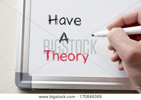 Human hand writing have a theory on whiteboard