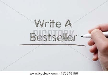 Human hand writing write a bestseller on whiteboard