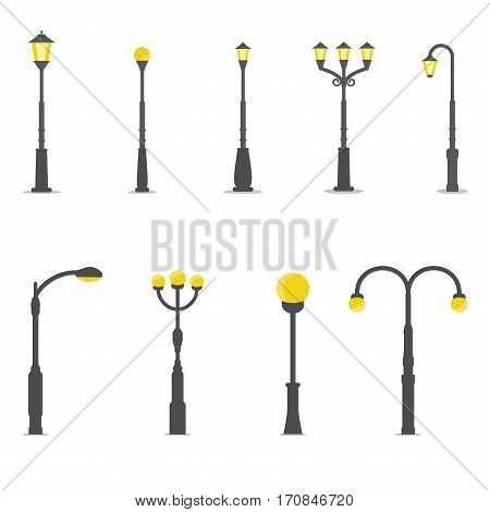 Flat style streetlamp set. Urban road lights and classic park street lamps. Simple and elegant pole with yellow lantern.