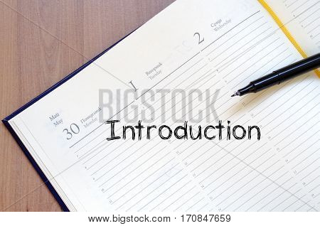 Introduction text concept write on notebook .