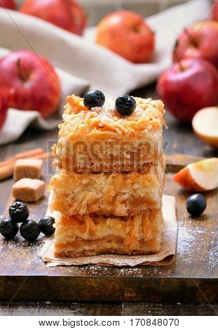 Apple pie decorated berry black chokeberry on wooden table close up
