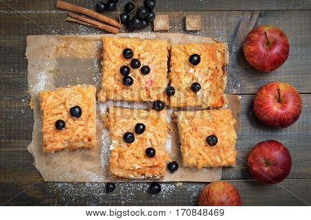 Homemade apple pie decorated berry black chokeberry on wooden table top view