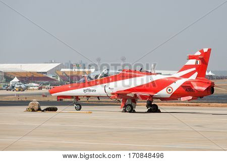 Bangalore India - February 12 2017: A plane from the Surya Kiran acrobatic team at the 11th edition of Aero India 2017 in Bangalore India. Over 200000 people are expected to attend.