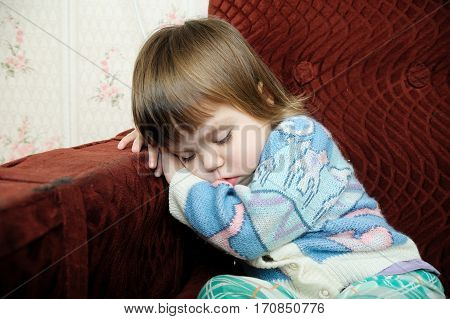 Exhausted child sleeping on chair tired kid fall asleep after playing