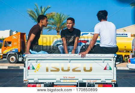 SHARM EL SHEIKH EGYPT - JULY 9 2009. three workers traveling in cars
