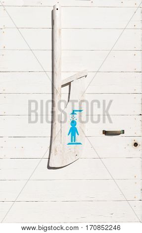 door of toilets with an oar decorated with symbols of the respective recipients men women the handicapped