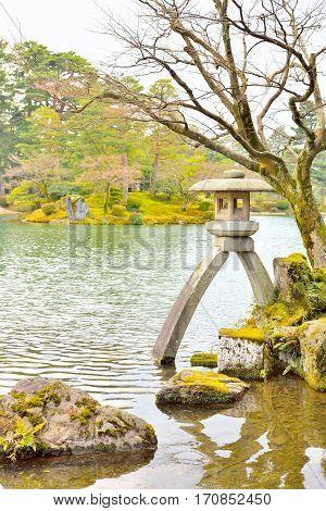 Famous stone lantern Kotoji-toro in Kenroku-en garden Kanawaza Japan.
