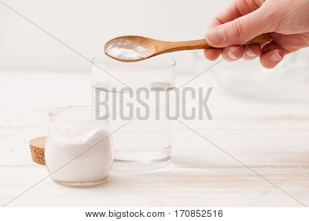 Sea Salt, Starch In The Jar And Wooden Spoon For Recipes Of Cosmetics At Home On A White Wooden Back