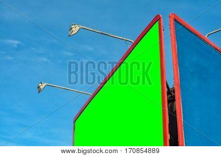 Blank billboard with Chroma key against blue sky. Red frame billboard