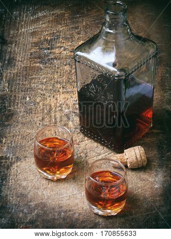 Two Glasses Of Brandy Or Cognac And Bottle