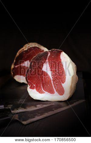Italian lunch meat culatello on a cutting board