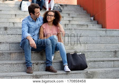 Romantic Interracial Couple Embraced In The City