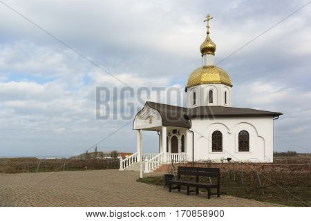 a Platform with a bench at the entrance to the Church is the chapel of the Holy righteous Theodore Ushakov Sunny winter day