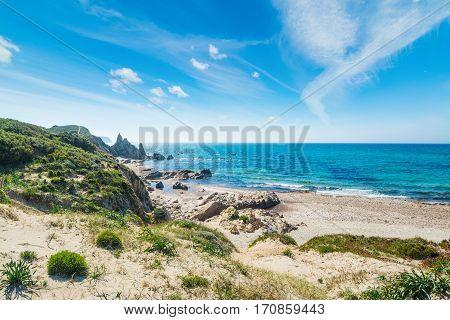 clouds over Rena Majore beach in Sardinia