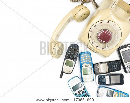 Old telephone and moblie phone on white background