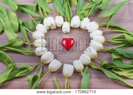 Love red heart of tulips lovely surprise present for girlfriend. Beautiful heart shape on wood in decoration one at one tulip. Wonderful gift for e.g. valentine's day mother's day wedding birthday or anniversary.