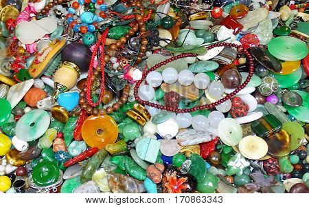 Ragbag of jewelry and jade on a market
