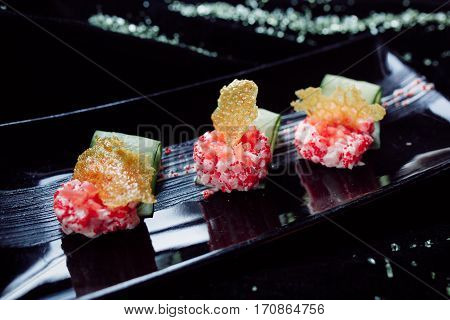 scallop tartare and salmon over black background