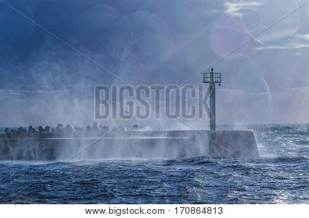 THE STORM - Water dust from broken storm waves on the breakwater