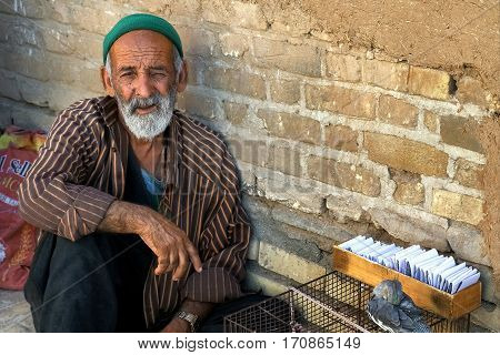 Iran Persia Isfahan - September 2016: elderly man wonders at the fulfillment of desires in the market in Isfahan.