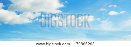 a blue sky with white soft clouds