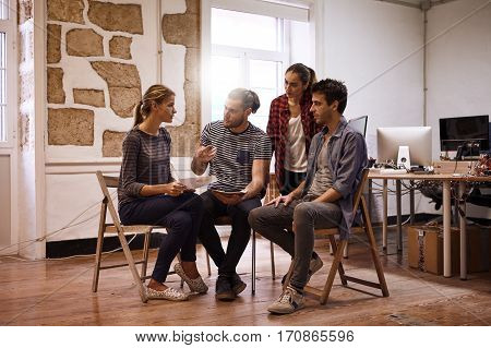 Young Business Team Gathered In Discussion
