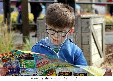 April 04 2016 - Windsor, Uk: A Young Boy Studies The Map Of The Legoland Theme Park