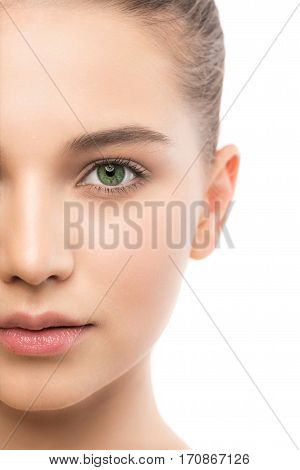 Portrait of beautiful young brunette woman with clean face. Beauty spa model girl with perfect fresh clean skin. Looking at camera and smiling. Youth and skin care concept. Isolated on a white background.
