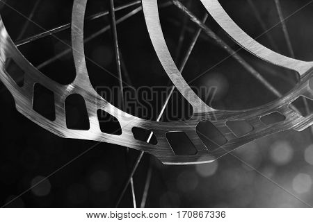 detail of a bicycle disc brake over blurry background