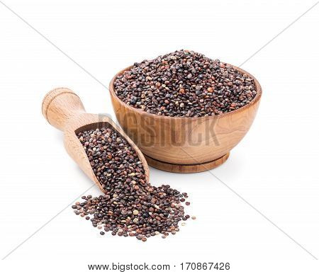 Black quinoa in a wooden bowl isolated on white background. Deep focus