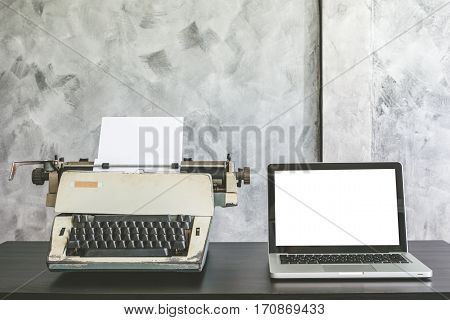 Old Typewriter and Laptop on the desk.