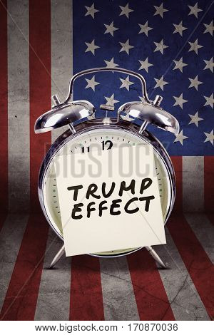Picture of Trump Effect word on the sticker paper with big alarm clock and flag of USA