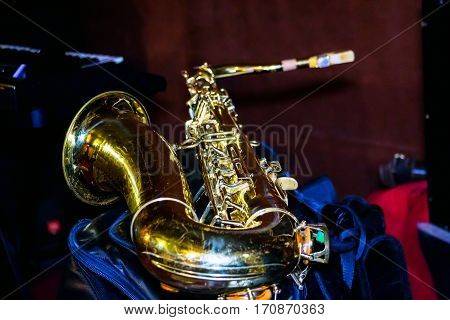 Photo tenor sax Golden color. The saxophone is in the rehearsal room