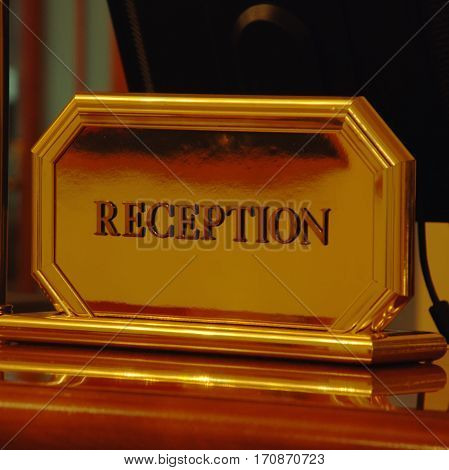 reception sign on a desk in hotel, square image