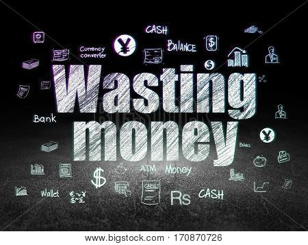 Money concept: Glowing text Wasting Money,  Hand Drawn Finance Icons in grunge dark room with Dirty Floor, black background