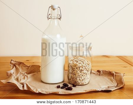 real comfort wooden kitchen with breakfast ingredients close up in glass, honey, oatmeal, milk, muesli, morning food