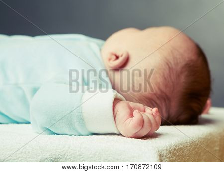 sleeping baby, focus on the hand