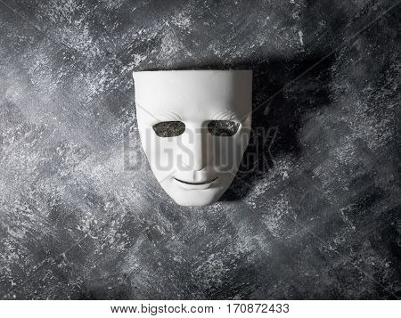 a White mask on gray grunge background.