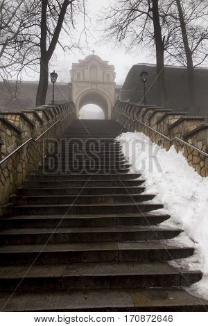 Stone stairs leading to the Basilica of St. Anne on Mount St. Anna in Poland in the winter fog
