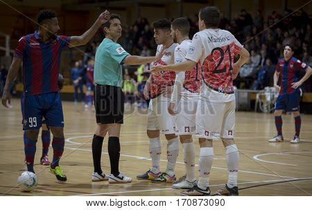 VALENCIA, SPAIN - FEBRUARY 7: Players and referee during Spanish King Cup match between Levante UD FS and Elpozo Murcia at Cabanyal Stadium on February 8, 2017 in Valencia, Spain