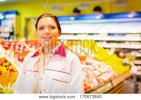 Female sales clerk working at the supermarket