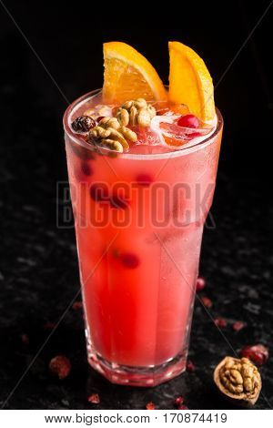 Cranberry cocktail with garnish on marble table