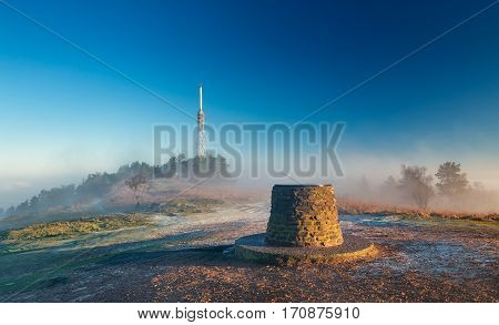 Transmitting Station at the Top of Hill in Morning Mist and Sunrise Light