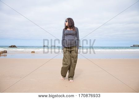 Grey Sweater Pregnant Walking At Beach