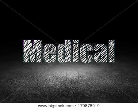 Healthcare concept: Glowing text Medical in grunge dark room with Dirty Floor, black background