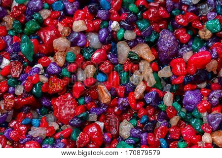 Multi-colored small colorful stonesminerals close-up as very nice natural background pattern wallpaper or banner design place for your text