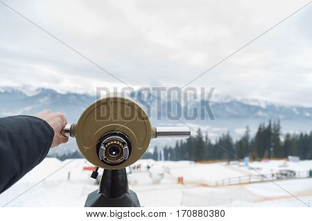 You can use the monocular to look to the mountains