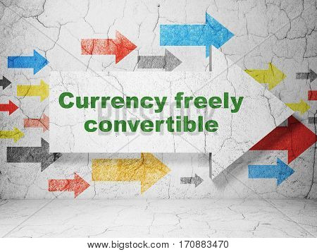Currency concept:  arrow with Currency freely Convertible on grunge textured concrete wall background, 3D rendering
